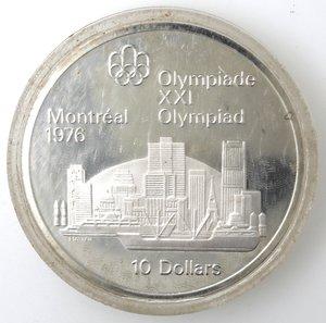 reverse: Monete Estere. Canada.Elisabetta II.10 Dollari 1973. Olimpiadi di Montreal 1976. Veduta di Montreal. AG 925. Km. 87. Peso gr. 48,6 0. FDC.