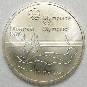 reverse: Monete Estere. Canada.Elisabetta II.10 Dollari 1975. Olimpiadi di Montreal 1976. Canottaggio. AG 925. Km. 104. Peso gr. 48,60. Diametro mm. 45.FDC.