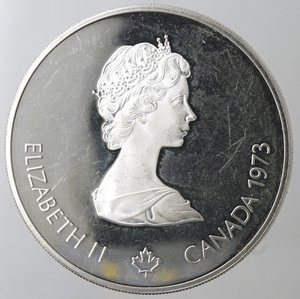 obverse: Monete Estere. Canada.Elisabetta II.5 Dollari 1973. Olimpiadi di Montreal 1976. Vela. AG 925. Km. 84. Peso gr. 24,21. Diametro mm. 38.qFDC.
