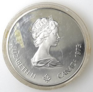 obverse: Monete Estere. Canada.Elisabetta II.5 Dollari 1973. Vele. Olimpiadi di Montreal 1976. AG 925. Km. 85. Peso gr. 24,37. Diametro mm. 38.FDC.