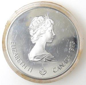 obverse: Monete Estere. Canada.Elisabetta II.5 Dollari 1973. Olimpiadi di Montreal 1976. Mappa del Nord America. AG 925. Km. 85. Peso gr. 24,30. Diametro mm. 38.FDC.