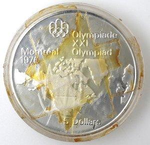 reverse: Monete Estere. Canada.Elisabetta II.5 Dollari 1973. Olimpiadi di Montreal 1976. Mappa del Nord America. AG 925. Km. 85. Peso gr. 24,30. Diametro mm. 38.FDC.