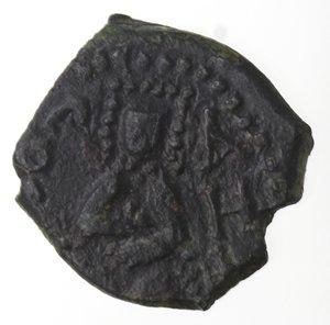 obverse: Zecche Italiane. Messina. Ruggiero II. 1105-1154. Mezzo follaro. Ae. Variante scritta inversa. Sph. 77. Peso gr. 1,94. Diametro mm. 13,50. qSPL.