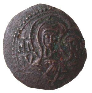 reverse: Zecche Italiane. Messina. Guglielmo I. 1154-1166. Frazione di follaro. Ae. Sph. 99. Peso gr. 1,45. Diametro mm. 14. BB+.