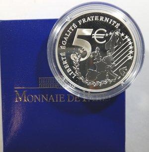 obverse: Monete Estere. Francia. 5 Franchi 2002. Au-Ag. Km. 1347. Peso Au gr. 2,7. Peso Ag 22,2.FDC Proof.In confezione della zecca.