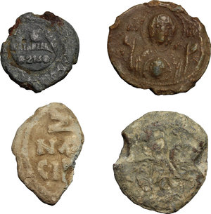 obverse: Byzantine Empire. Multiple lot of four (4) unclassified PB Seals, 10-12th century