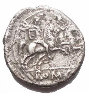 reverse: RepubblicaRomana - Denaro anonimo. 211-209 ac.D/ Testa elmata di Roma a destra.R/ Dioscuri a destra, in esergo ROMA.Gr. 4,02. mm 19,26.AG.Cr 53/2. BB++/BB