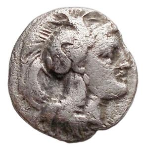 obverse: Mondo Greco - Lucania. Thurium.(IV sec. AC.). Diobolo.D/ Testa di Athena a destra, che indossa elmo decorato con mostro Scilla.R/ Toro cozzante a destra. AG. 0,78 gr.BB