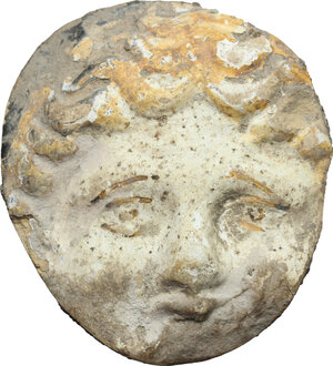 obverse: Decorative mask element from a volute krater handle.  Greek, 4th century BC.  43 mm x 38 mm