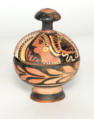 obverse: Apulian red-figure pyxis with winged head of Nike  4th century BC.  8,5 diameter, 11.5 cm high