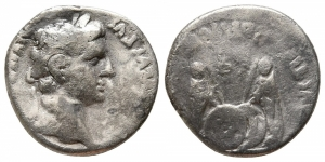 obverse: Augustus (27 a.C. - 14 d.C.) Lugdunum (Lyon). AR Denarius (17 mm. - 3,50 gr.). D.\: CAESAR AVGVSTVS DIVI F PATER PATRIAE, laureate head right. R.\: AVGVSTI F COS DESIG PRINC IVVENT, Gaius and Lucius Caesar standing facing; shields and spears between; simpulum and lituus above; C L CAESARES in exergue. RIC I 207; Lyon 82; RSC 43. MB.