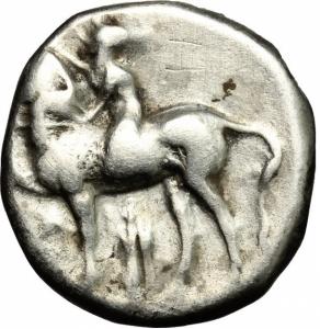 obverse: Calabria. Taranto (380-340 a.C.). AR Nomos (7.75 gr. – 20 mm.). D.\: giovane che cavalca un cavallo a sinistra. R.\: Phalantos cavalca delfino a sinistra. HN Italy 868. qBB. NC.