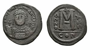 obverse: Giustinianus I (527-565), Costantinopoli. AE Follis (39 mm. - 22,11 gr.). Datato RY 14. D.\: D N IVSTINIANVS P P AVG.Helmeted and cuirassed bust facing, holding globus cruciger and shield decorated with horseman motif; cross to right. R.\: Large M; A/N/N/O - X/ II/ II across field; cross above,? below; CON. BB. Moneta dal diametro molto ampio!