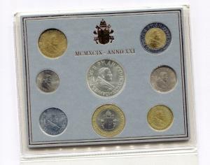 obverse: Vaticano. Folder Ufficiale del 1999 con 7 monete FDC (di cui una in argento). (Val. Cat.: 115€)