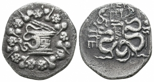 obverse: Mysia. Pergamon (circa 166-67 BC). Struck 123-104 BC. AR Cistophorus (25 mm. - 9,79 gr.). D.\: Cista Mystica from which snake coils, around, ivy wreath with fruits. R.\: Two snakes coiled around a bow case, between the snake heads, monogram of ME, to left, monogram of ΠΕΡΓ, to right, staff of Asklepios. Kleiner, Hoard 18. qBB. NC.
