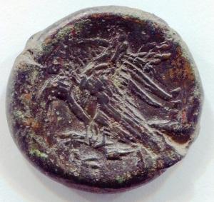 reverse: Sicilia. AKRAGAS [Agrigento] (289 a.C.). AE 25 (12,11 gr.). D.\: testa di ninfa a sinistra; R.\: aquila con ali aperte mentre mangia coniglio. qBB. R.