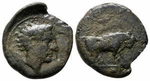 obverse: Sicilia, Gela (circa 420-405 a.C.). AE Trionkion (18 mm. - 3.45 gr.). D.\: testa di Gela a destra, chicco di grano dietro. R.\: Toro stante a destra, sotto 3 globetti. SNG COP. 285. qBB. NC.
