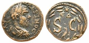 obverse: Macrino (217-218). Seleucis e Pieria, Antiochia. AE Bronzo (20 mm. - 4,78 gr.). R.\: SC entro corona d alloro, aquila sotto, monogramma e stella sopra. qBB. R1.