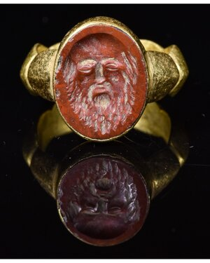 obverse: ROMAN GOLD INTAGLIO RING WITH SATYR