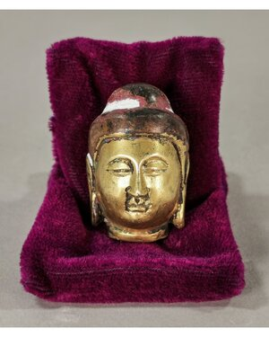 obverse: TANG DYNASTY GILT BUDDHA HEAD