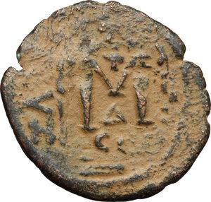reverse: Arab-byzantine, Umayyad Caliphate, pre-reform coinage.. AE Fals, Tiberias mint, 41-77 H / 661-697 AD