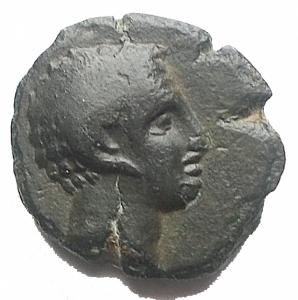 obverse: Mondo Greco - Lucania. Metaponto. 3 Sec ac. AE. gr 1,77. d/ Testa di Apollo Carneius a ds r/ META Spiga. BB. Bella patina verde intenso