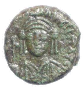 obverse: Bizantini. Maurizio Tiberio. 582-602 d.C.  Decanummo. Catania. D/ Busto frontale. R/ ANNO I in esergo CON. Sear 580. Peso 3,75 gr. Diametro 14,64 mm. BB+.