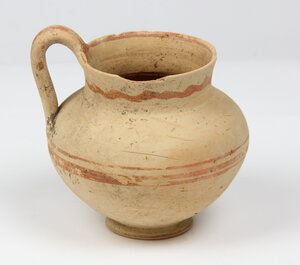 obverse: Daunian Pottery olpe.  Bulbous body, strap handle, flared rim and painted reddish-brown bands.  3rd century BC.  H. 12 cm (with handle)