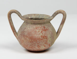 obverse: Apulian Pottery Kantharos.  Bi-conical body, everted rim and high looped strap handles.  Circa 4th century BC.  15 cm height.  Intact