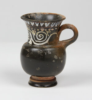 reverse: Gnathia-Ware kotha.  Elongated neck with added white and yellow zigzag decoration.  Apulia, 4th century BC.  H. 11 cm
