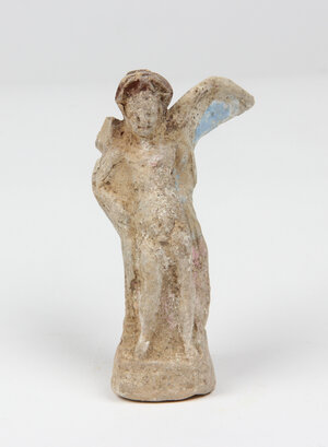 obverse: Terracotta tanagra statuette of Eros.  Traces of original colors.  Greek, 3rd century BC.  H 10.5 cm  Right wing missing