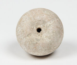 obverse: Terracotta Pomegranate.  Spherical body, hollow, with four lines on the top. Traces of withe paint.  Greek, 3rd century BC.  H 4.5 cm, Ø 5.5 cm