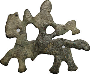 reverse: Bronze Slavic pendadnt in shape of warrior on horseback holding axe.  Early medieval period, 7-8th century.  38 mm