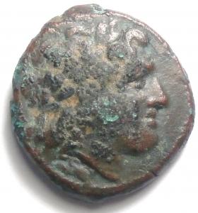 obverse: Mondo Greco. Bruttium. Nuceria. 350-270 a.C. Obolo. Ae. D/ Testa laureata di Apollo verso destra. R/  Cavallo verso sinistra, tra le zampepentagramma. SNG ANS 597.Peso 8,53 gr. Diametro 21 mm.BB. R.