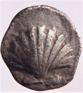 obverse: Mondo Greco. Calabria. Tarentum. 325-280 a.C. Diobolo. AG. D/ Conchiglia. R/ Delfino a destra, simbolo stella . Peso gr. 0,70. Diametro mm. 9. SNG ANS 1488.BB+. RR....
