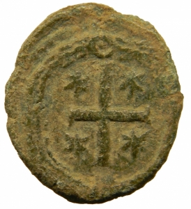 reverse: Bizantini. Giustiniano I. 527-565 d.C. AE Decanummo. Ravenna ?. D/ DN IVSTINIANVS PP AVG, Busto frontale. R/ Grande croce tra 4 stelle. Peso 3,75 gr. Diametro 17,79 mm.DO 366. BB+. Patina.=