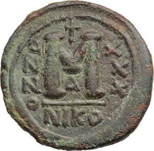 reverse: Justinian I (527-565).. AE Follis. Nicomedia mint, 1st officina. Dated RY 30 (556/7 AD)