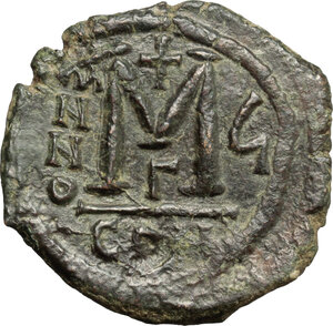 reverse: Justin II, with Sophia (565-578). . AE Follis. Constantinople mint, 3rd officina. Dated RY 6 (570/1)