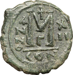 reverse: Justin II (565-578).. AE Follis. Constantinople mint, 3rd officina. Dated RY 12 (576/7)