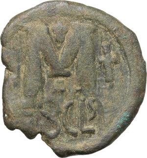 reverse: Heraclius (610-641). AE Follis. Syracuse mint. Struck 615/6-627/8. Countermarked on a follis of Justin I, struck 518-522 (Sear 64)