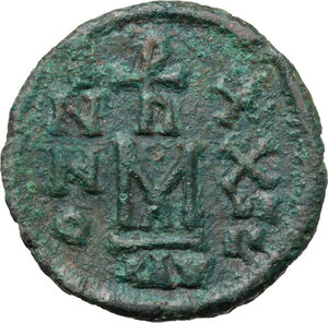 reverse: Heraclius, with Heraclius Constantine and Heraclonas (610-641).. AE Follis. Ravenna mint. Dated RY 24 (633/4)