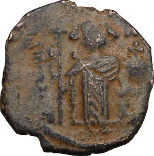 obverse: Arab-Byzantine, Umayyad Caliphate. AE Fals, Hims (Emesa) mint, c. 680-693