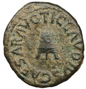 obverse: Claudius. A.D. 41-54. AE Quadrans. 3.05 gr. - 18,7 mm. Struck 42 AD. O:\ TI. CLAVDIVS CAESAR AVG. around three-legged modius. R:\ PON. M. TR. P. IMP. P. P. COS. II around S.C. RIC 126, 90. BMC 182. XF