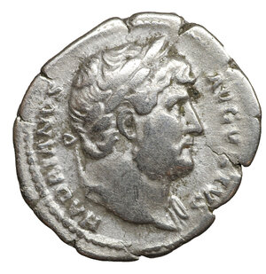 obverse: Hadrian AR Denarius. Rome, AD 125-128. 21 mm., 3,07 g. O:\ HADRIANVS AVGVSTVS, laureate head right, drapery on far left shoulder. R:\ COS [I]II, Victory seated left, holding wreath and palm; globe in exergue. RIC 184; RSC 361b; BMCRE 428. XF
