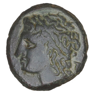 obverse: Sicily. Syracuse. Bronze under tyrant Hiketas II. 288-278 BC. AE 10.13 gr. – 23.7 mm. O:\ Laureate head of Zeus Hellanios l. R:\ [ΣYPAK] - OΣIΩN, eagle standing l. on thunderbolt, with wings displayed. CNS II, 158. Dark Green olive patina. aUNC