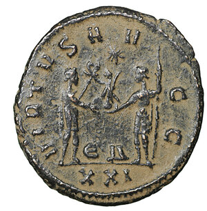 reverse: Carinus 283-284 AD. Antoninianus. Antioch. 3.93 gr. – 20.8 mm. O:\ Radiate and cuirassed bust right. R:\ VIRTVS AVGG Emperor standing right holding sceptre, receiving Victoria from Jupiter (XXI in ex.). RIC 325. Scarce. XF