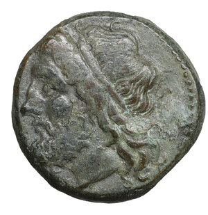obverse: Sicily, Syracuse. Hieron II (275-215 BC). Bronze. 6.70 gr. – 19.2 mm .O:\ Diademed head of Poseidon left. R:\ IEPΩNOΣ, Ornate trident head, flanked by two dolphins. SNG ANS 964. XF+