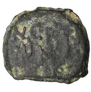 reverse: Porcius Festus. 59-62 C.E. Æ prutah. 2.25 gr. - 15.8 mm. Procurator under Nero, Dated year 5 = 58/59 CE. O:\ NЄP/WNO/C, legend within wreath, bottom tied with X. R:\ LЄ KAICAPOC, palm branch. Hendin 1351; Meshorer TJC 345; RPC 4972. VF