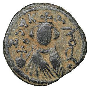 obverse: ARAB-BYZANTINE. 660s-680s. AE fals. Hims (Emesa). 3.20 gr. – 19,4 mm. O:\ Facing imperial bust, holding globus cruciger; KAΛωN to left, bi-hims to right. R:\ arge m; star between two scroll ornaments above, ЄMI-CHC flanking, tayyib below. Album 3524; SICA 548; Walker 57. Rare. XF