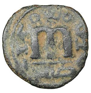 reverse: ARAB-BYZANTINE. 660s-680s. AE fals. Hims (Emesa). 3.20 gr. – 19,4 mm. O:\ Facing imperial bust, holding globus cruciger; KAΛωN to left, bi-hims to right. R:\ arge m; star between two scroll ornaments above, ЄMI-CHC flanking, tayyib below. Album 3524; SICA 548; Walker 57. Rare. XF